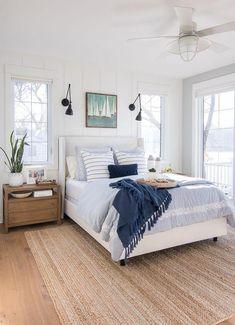white upholstered bed lake house master bedroom blue and white bedroom, coastal bedroom decor with sconces and shiplap, jute rug and blue bedding, lake house bedroom decor, coastal bedroom decor Coastal Bedrooms, Luxurious Bedrooms, Trendy Bedroom, Coastal Master Bedroom, Bedroom Neutral, Nautical Bedroom, Romantic Bedrooms, Neutral Bedding, Bedroom Green