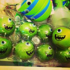 Monster University christmas ornaments... clear ball ornaments with neon green paint inside and google eye!