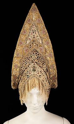 Headdress    Date:      fourth quarter 18th century  Culture:      Russian  Medium:      silk, mother-of-pearl, metal, glass, cotton, paper