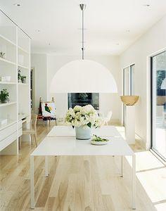 fantastic light and flower pot beneath. Love the sliding doors, light wood floors, light flooding in.