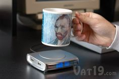 USB Drink Warmer with 4-port USB Hub  Keeps your coffee warm, powers USB devices, and tells the time.