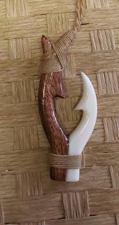 Hand carved Hawaiian Koa and Bone double fish hook necklace. Adjustable rope to fit any neck size