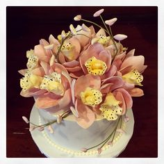 Super pretty!!! Congratulations Steven and Tracy - we hope you love your orchid wedding cake as much as we enjoyed making it! Have fun in NYC!! Photo by Sugar Flower Cake Shop. www.sugarflowercakeshop.com