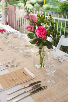 long colourful wedding table with burlap runner. Menu with cutlery