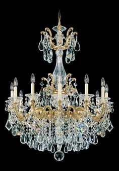 This rendition of La Scala exhibits a variety of design motifs, all of them tending to magnificence. Empire styling is evident in the crystal basket densely woven of chains of octagons. Rococo influen