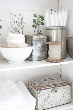 Old tin containers white on white with botanical prints - gorgeous vigniette.  VIBEKE DESIGN blog