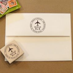 Love the airplane stamp. (http://www.etsy.com/listing/112568080/airplane-rubber-stamp-for-wedding-return)