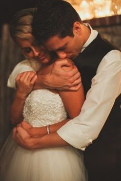 I love photos with passion. Add this one to the list! Wedding Photo | Hugs her loves her | Embrace pose | Hold her tight | Nighttime wedding photography | Photography ideas