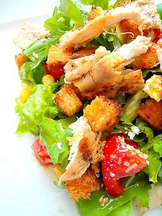 salad with lettuce, arugula and grilled chicken