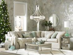 A glamorous transitional crystal chandelier in a holiday-ready living room | luxury look, living room, mirrored furniture, holiday