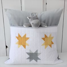 This pillow has a fun detail - a pocket! It's perfect for slipping a couple of books into or even a couple of little toys. A great reading...