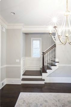 Living room Design Dark Wood Floors Grey Walls Stairs 67 Ideas Aside from proper soil Custom Home Builders, House Design, Staircase Design, New Staircase, Grey Walls, Dark Wood Floors, Moldings And Trim, Living Room Wood Floor, Stairs