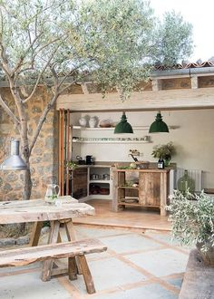 modern rustic interiors This home on the island of Mallorca (Spain) has been designed by Spanish architectural firm Moredesign. Building the rustic stone house was a process ove Outdoor Kitchen Design, Rustic Kitchen, Backyard Kitchen, Rustic Outdoor Spaces, Indoor Outdoor Kitchen, Kitchen Modern, Open Kitchen, Outdoor Areas, Outdoor Rooms