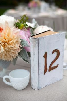 book table numbers, such a nice and classic idea. Book Table Numbers, Wedding Table Numbers, Wedding Seating, Rustic Wedding, Wedding Reception, Table Setting Inspiration, Wedding Inspiration, Wedding Ideas, Wedding Book