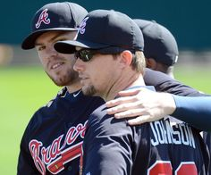 Atlanta Braves infielder Freddie Freeman (left) puts his arm around Atlanta Braves infielder Chris Johnson during the third full squad workout at Champion Stadium in the ESPN Wide World of Sports Complex in Lake Buena Vista, Fl., on Sunday, Feb. 17, 2013.