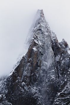 "hugovincentphotography:  "" The W face of Les Drus comes out of the clouds, dusted with fresh snow. The lighter grey parts show the scale of the massive rockfalls happening since the 50's, taking out some of the most classic climbs in the history of..."