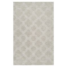Anchor your living room or define a space in your master suite with this hand-loomed rug, showcasing a quatrefoil-inspired trellis motif in palm green.