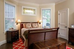 Guest bedroom suite with stained glass from 1903.  Designed and renovated by Ramage Company.