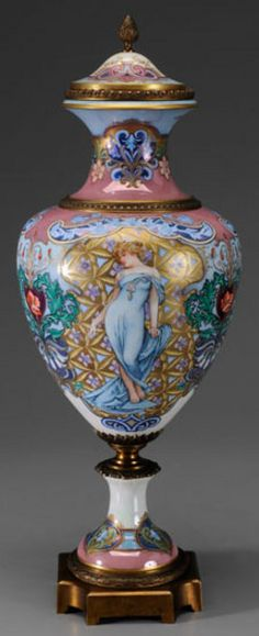 A monumental Sevres Art Nouveau urn and lid, French, late-19th to early-20th century, Sevres or Sevres style porcelain decorated in the Art Nouveau taste with two women in luxurious settings, signed Collinet