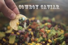 Cowboy caviar dip - corn, black beans, tomatoes, avocadoes, onion, garlic, olive oil, cilantro, and salt and cumin