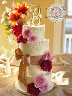 Buttercream fall wedding cake.  Features a rose gold fondant bow and wafer paper flowers