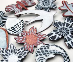 Enamel on copper shaped brooches by Janine Partington.