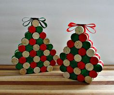 These fun tabletop Christmas trees are sure to brighten your holiday! Upcycled wine corks have been painted red and green with some left natural and glued together in a tree shape. Ribbon has been added to the sides (red on one tree,green on the other) and the top finished with a little matching bow and wood snowflake in silver on top. What a great addition to your holiday mantle, table or wedding decor! Set of 2. Measurements: Large ~7.5 high x 6.5 wide x 1.5 deep Small ~6.5 high x 5.5…