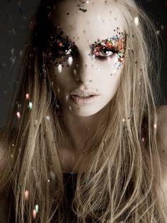 Beautiful glittery stars makeup on model Dioni Tabbers.