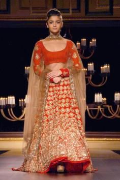 Actor Alia Bhatt at designer Manish Malhotra`s show at the India Couture Week 2014, in New Delhi on July 19, 2014. (Photo: IANS/Amlan Paliwal) Indian wedding clothes, red bridal lehenga