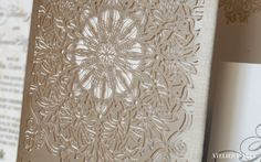 Laser cut wedding invitation inspired by lace