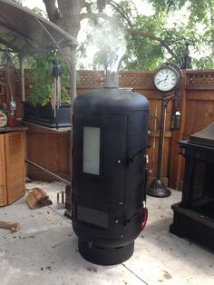 A backyard smoker made from a discarded water pressure tank and other reclaimed parts. Like oven door glass and the exhaust pipe from a semi.