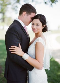 David's Bridal bride Sylvie in a lace cap sleeve v-neck wedding gown and elbow length veil at her classic Southern wedding.