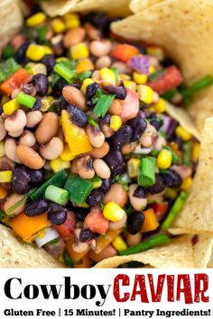 Cowboy Caviar made with beans, corn, bell peppers, cilantro, and green onions in tangy homemade dressing is the perfect party dip! Serve with tortilla chips, or as a salad for a #potluck or #BBQ #glutenfree #recipe #easy #pantry #salad #blackeyedpeas
