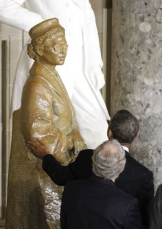 President Barack Obama reaches out to touch a statue in honor of civil rights activist Rosa Parks, at its unveiling in Statuary Hall in the U.S. Capitol in Washington, February 27 | The Obama Diary