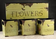 Set of 4 Tin Flower Planters $39 IN BRIDES SEPT.2012