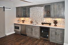 19 - Bar Design Inspiration - Backsplash #interiordesign #bar #basement #tiledesign #tile #dreamhome #luxuryhome #gray #barnwood #flooring #LVT #luxuryvinylplank