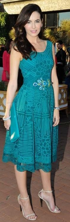 Who made Camilla Belle's green lace dress?