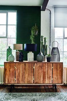 Fusing industrial chic with jungle-inspired design, this diverse trend juxtaposes worn leathers and rustic woods with botanical prints and an abundance of greenery, for a look that is both urban and earthy.