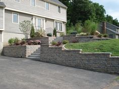 Interlocking Paver Walls & Paver Retaining Walls in Connecticut - front yard landscaping ideas entryway Retaining Wall Design, Garden Retaining Wall, Concrete Retaining Walls, Landscaping Retaining Walls, Hillside Landscaping, Driveway Landscaping, Landscaping Ideas, Sloped Front Yard, Exterior Color Palette