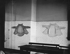 Immigrants' shirts drying in the waiting room of the deportation station on Ellis Island.  Photo, 1931, by Erich Salomon.  Published by: 'Berliner Illustrirte Zeitung' 20/1932