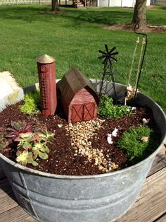 Pinner says:This is my first Fairy Garden. I plan on adding a John Deer Tractor. I LOVE IT, now I want to do my next one like this, with a John Deere as well, of course.