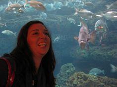 Goofy daughter making a fish face at the Atlanta Aquarium - July, 2013