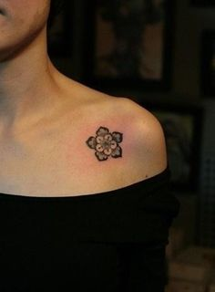 Flower tattoo on the chest/shoulder