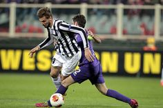 Gonzalo Rodriguez of ACF Fiorentina fights for the ball with Fernando Llorente of Juventus during the UEFA Europa League Round of 16 second ...
