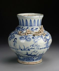 China, Ming Period, very rare blue and white jar, in bulbous from with tapered neck, two chi dragons with figure in landscape motifs, and geometric details. Diameter 7 1/2 in., Height 8 1/2 in.