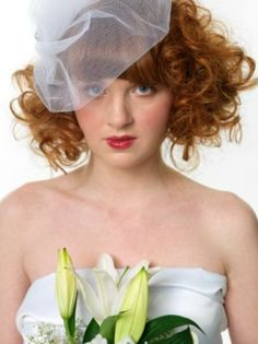 Have a long bob? Add drama to your red hair by creating tight ringlets for a retro vintage effect!