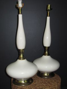 """""""I Dream of Jeannie"""": pair of decorator white ceramic with brass detail, 25""""H."""