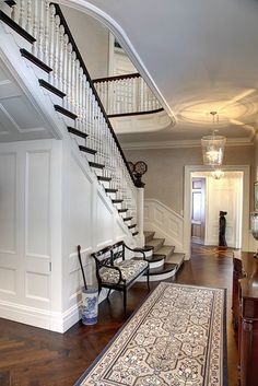 Classical mouldings and chevron-patterned black walnut flooring in the entry hall sets the tone for the rest of the home.