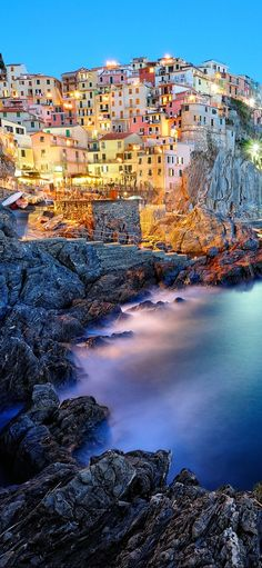 Manarola, Italy • Besides the beauty of this little town, hiking your way down to other towns nearby is the main reason why tourists find this village attractive. This is a small fishing town which belongs to the Cinque Terre if Italy which translates to five lands which are connected by one walking path.