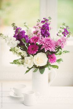 Purple and white flower bouquet in a white jug by Ruth Black